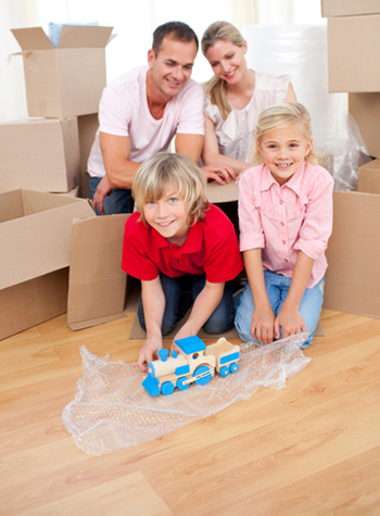Family with Children Packing for Move