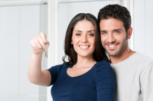 Couple with keys for new house