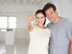 Couple Holding the Keys to New Home